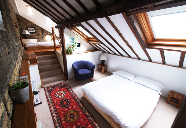 The split-level Long Loft Room with balcony.